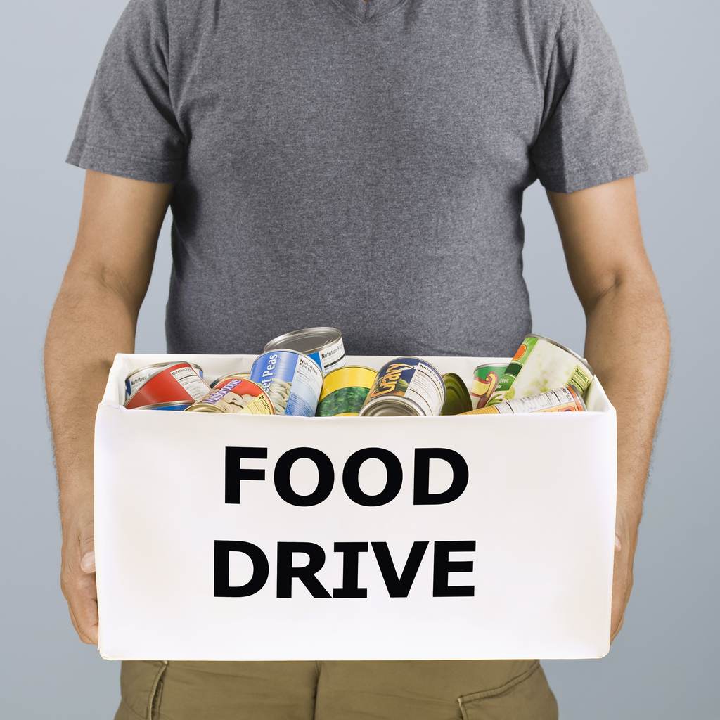 Man holding food drive box